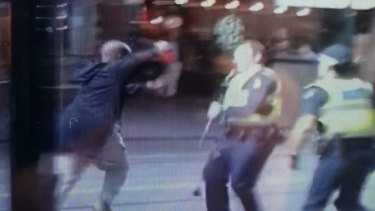 Hassan Khalif Shire Ali lunge at police with a knife before he was shot in the chest.