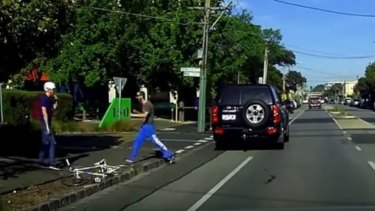 The cyclist is approached by the driver.