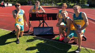 Teen sensation Jake Doran poses (on the clock) with his 100m Australian record sprint time, and his team in Finland.