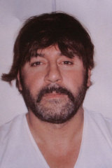 Tony Mokbel was arrested in Greece while wearing an ill-fitting wig.