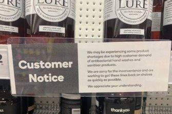 A sign at a Woolworths store in Victoria informing customers of the shortage of hand sanitiser.