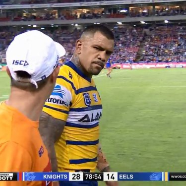 If looks could kill: Manu Ma'u has a 'discussion' with an Eels trainer over a head injury assessment.