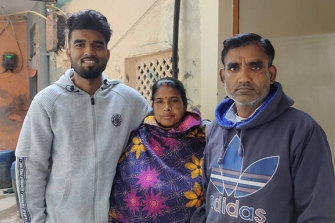 Amritesh Kumar Maurya with his parents at their home in Delhi.