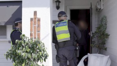 Police visit a woman who recently returned from Bali to ensure she is self-isolating.