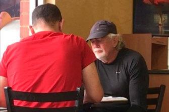 Casey councillor Sam Aziz and developer John Woodman meeting at a Subway restaurant in April 2018.