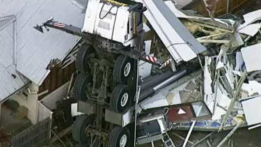 A crane has collapsed onto a house in Yarraville.