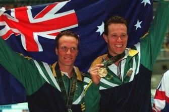 Silver medallist Daniel Kowalski and Olympic champion Kieren Perkins after the 1500m in Atlanta.