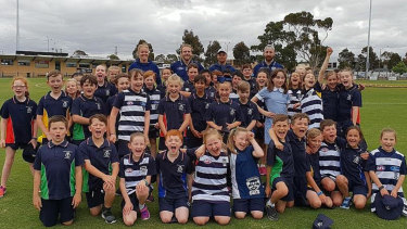 Geelong players Kate Darby, Cam Guthrie, Brandon Parfitt and Zach Tuohy at a Healthy Heroes clinic.