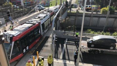 A car has crashed into a tram on South Dowling Street, Surry Hills.
