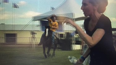 Aprotester's video of a man riding a horse in Clermont showground before a woman was hit. Police have laid charges.