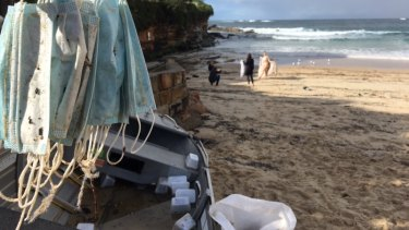 Masks collected on Coogee Beach after containers fell from a ship.