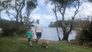 "Berrara resident Matt Jansch, with son Joshua at Berrara Lagoon, said locals were scared of the ""influx of people"" in recent weeks."