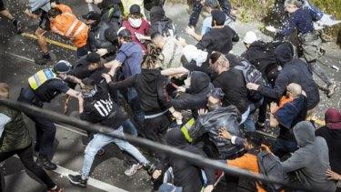 Six officers in hospital, 235 arrests after anti-lockdown protest turns violent