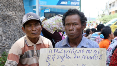 Cambodian villagers protesting in 2014 after they were forcibly evicted from land to make way for a sugar plant financed by the ANZ bank.