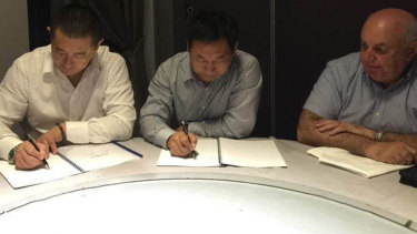 Wensheng Liu, Yuqing Liu and Vince Badalati at the signing ceremony in Sydney's Chinatown.