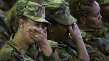 Members of the military shed a tear during a state ceremony for assassinated army chief General Seare Mekonnen.