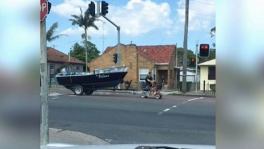 A video of Mr Swancott towing his 17 foot boat on a mobility scooter went viral online.