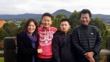 Kinley Wangyel Wangchuck  (in black second from right) with his mother Jangchu, father Tshering and brother Tenzin.