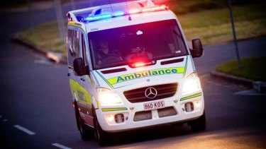 A man suffered burns to his hands, arms and back after falling into a bonfire.