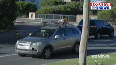 The boy on top of the car.