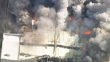 More than dozen firefighters are battling a fire that has tore through a food processing factory in Melbourne's south-east.