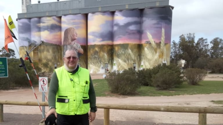 Canberra man Shane Stroud at Kimba in South Australian, known as the half-way point across Australia and now home also to this beautiful mural on grain silos by Melbourne artist Cam Scale.