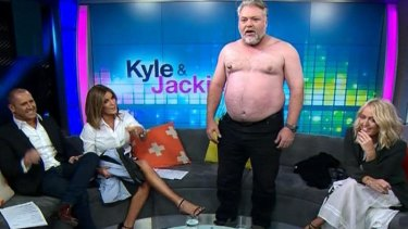 Kyle Sandilands takes his top off on Channel 7's <i>The Morning Show</I> alongside  Larry Emdur (left), Kylie Gillies and Jackie 'O' Henderson in 2015.