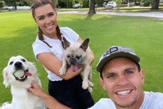 Matt Toomua and girlfriend Naomi with their dogs.