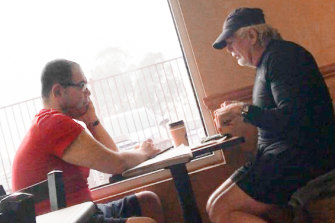 An IBAC surveillance photo of Sam Aziz (left) meeting developer John Woodman at a Subway restaurant in the suburb of Skye, in April 2018.