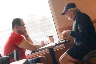 Casey councillor Sam Aziz (L) and developer John Woodman (R) meet at a Subway restaurant in April 2018.