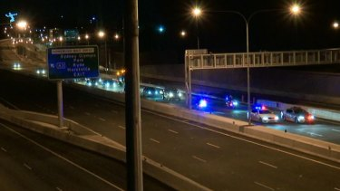 A convoy passes through at the opening to traffic of the M4 East tunnels at 2am on Saturday.