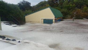 Facilities half submerged in slush and hail