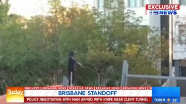 Police negotiated with the armed man, who was on top of the Clem7 tunnel entrance in Kangaroo Point.