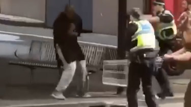 Police confront the knifeman