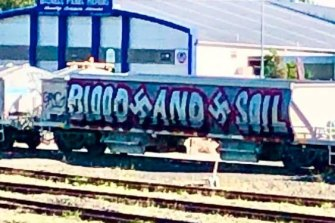 The original pro-Nazi graffiti on the carriage.