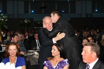 Alan Jones is embraced by James Packer in 2010 in front of Deeta Colvin, Erica Packer and Phil Gould.