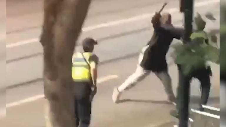The man lashes out at police before being shot.