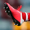 AFL warns of big fines for metal studs breaches after gruesome injury