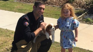 Jackson with his young owner and firefighter Craig Robinson.