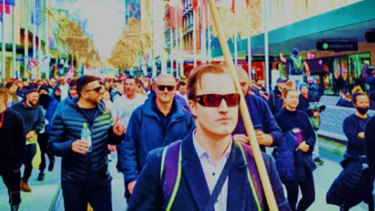 Harrison Mclean (front) was charged by police after the Melbourne lockdown protest rally on September 18.