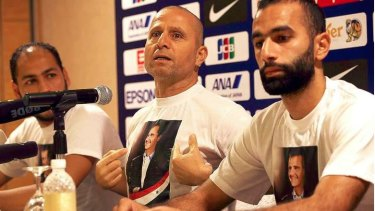 New man in charge: Interim Syria coach Fajr Ibrahim, wearing a T-shirt bearing the image of Syria President Bashar Al-Assad, pictured during a previous stint in charge of the national team.