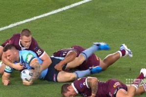 The Queensland hooker hit the deck hard after being steamrolled by Nathan Brown.