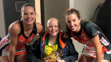 Giants players Kiera Austin and Amy Parmenter with Molly Croft.
