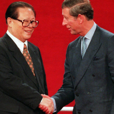 Chinese President Jiang Zemin, left, shakes hands with Prince Charles during the handover ceremony of Hong Kong to Chinese rule July 1, 1997.