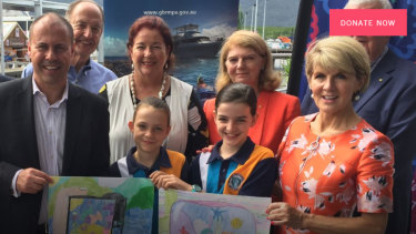 Josh Frydenberg, front,left, and Julie Bishop flank two students from a Reef Guardian school at the announcement in Cairns in April to grant the Great Barrier Reef Foundation almost half a billion dollars.