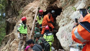 Rescue workers scramble to reach survivors still inside the collapsed illegal gold mine.