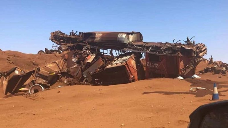 BHP iron ore train driver sues company over sacking after derailment