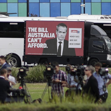 A truck drives past media setting up for a doorstop interview during Bill Shorten's visit to Casey Hospital.