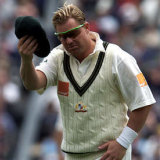 Shane Warne in his playing days with with baggy green in hand.