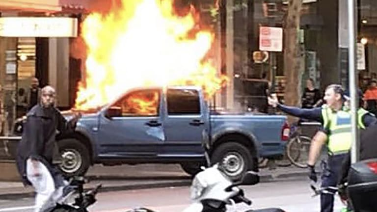 Image result for 24) Hassan Khalif Shire Ali sets his fire car on fire in Melbourne's Bourke street and starts stabbing people.
